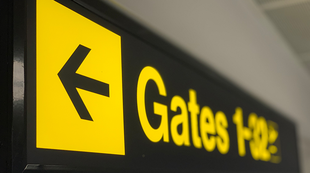 Airport Signpost that reads 'gates 1-32'