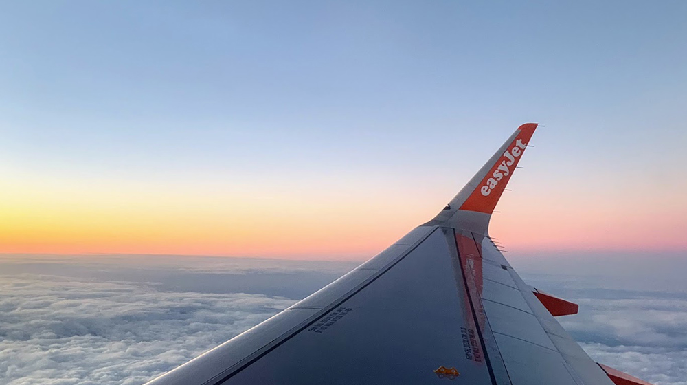 Plane wing shot during sunrise