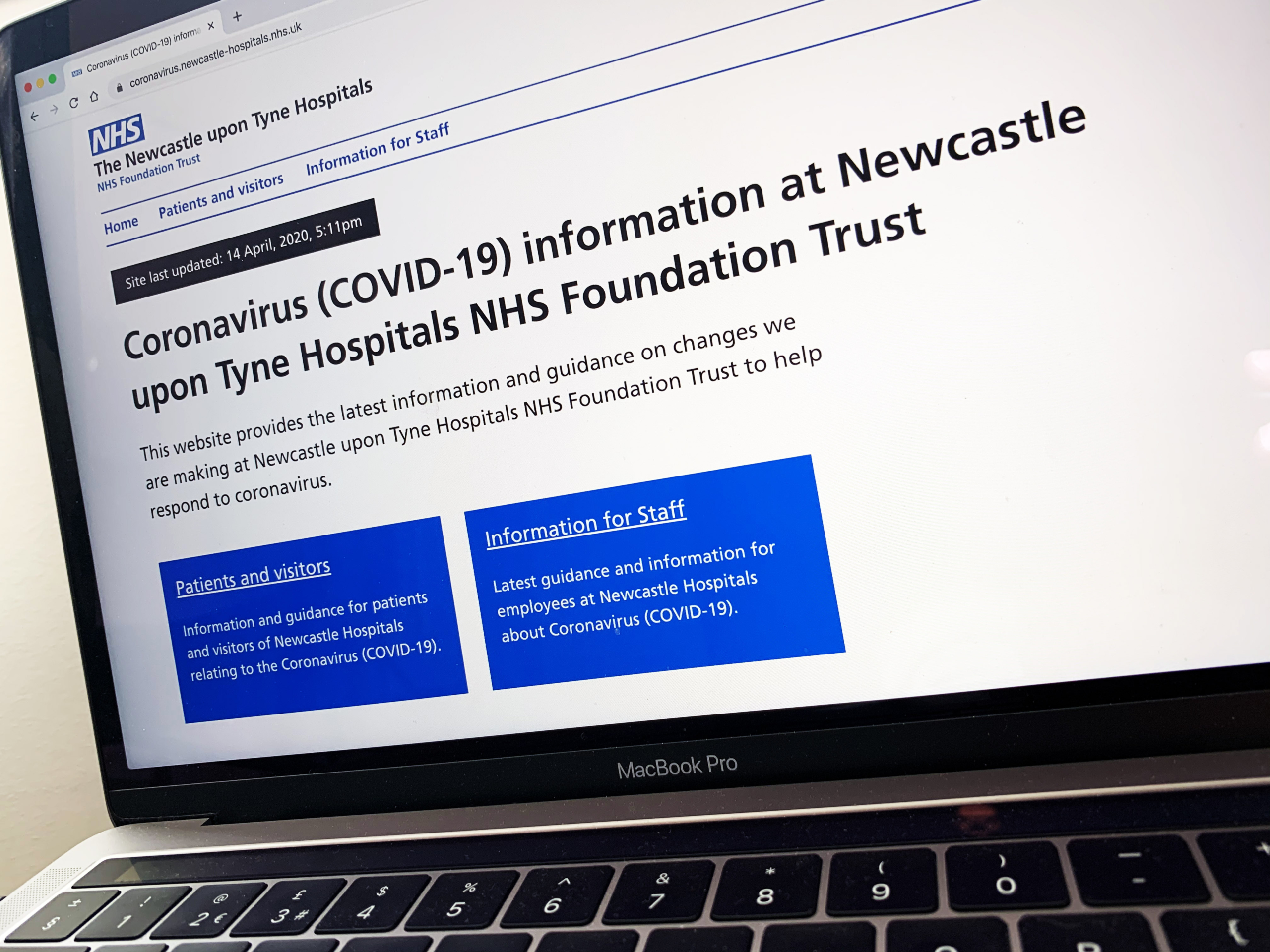 coronavirus webpage on laptop.