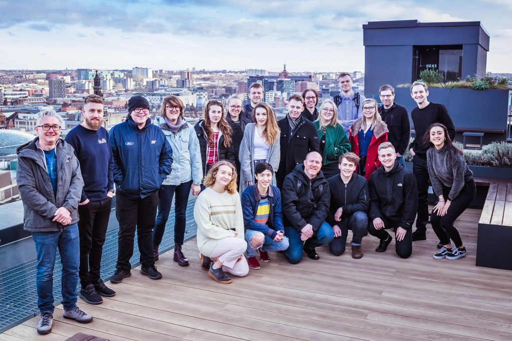Attendees and Mixd team posing for a photo on the roof of the Platform building in Leeds